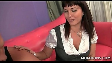 Lusty MILF strips and gives anilingus to a guy